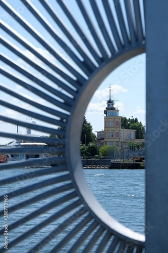 Port Master's Office building in Gdansk Nowy Port framed by a fence. Poland - fototapety na wymiar