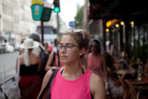 Fotografia, Obraz Beautiful french girl walking by parisian streets
