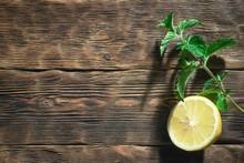 Lemon And Mint Leaf On A Woode...
