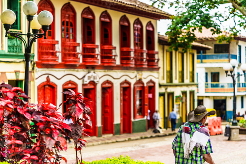 Garden Poster Paris View on colorful red colonial buildings at central square of village Jerico in Colombia