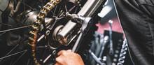 Mechanic Working On Motorcycle...