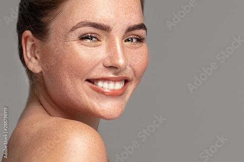 Fototapeta  Beauty ginger girl with freckles.