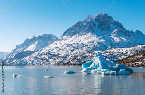 Icebergs flowing on Lago Grey lake in winter coming from the Grey glacier with the Paine Grande mountain peak in the background inside Torres del Paine national park, Patagonia, Chile Wallpaper Mural