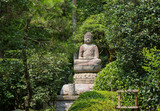Statue of Buddha in the woods in Kyoto, Japan.