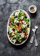 Greek chickpeas salad on dark background, top view. Vegetarian healthy diet food