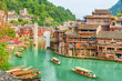 Leinwanddruck Bild - Fabulous view of wooden tourist boats on the Tuojiang River