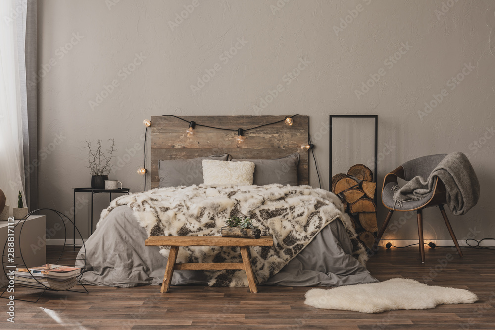 Fototapety, obrazy: Copy space on empty grey wall of stylish bedroom interior with wooden accents and king size bed