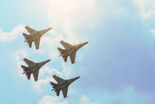 Group Of Four Aircraft Fighter Jet Airplane Sun Glow Toned Gradient Clouds Sky.