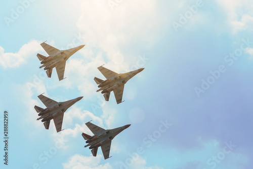 Fotografia, Obraz Group of four aircraft fighter jet airplane sun glow toned gradient clouds sky