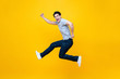 canvas print picture - Fun energetic young handsome Asian man jumping in mid-air