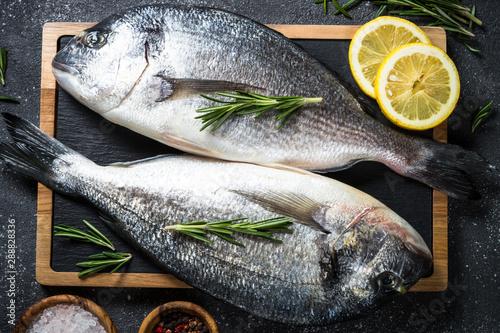 Fotografie, Obraz  Raw dorado fish on black