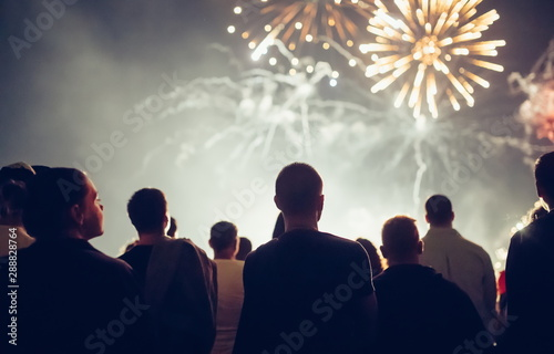 Fototapety, obrazy: Crowd watching fireworks and celebrating new year eve