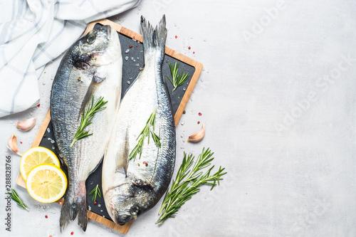 Fotografie, Obraz  Fresh fish dorado on blue background.