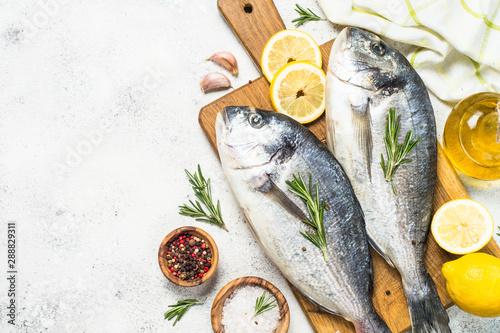 Obraz na plátně  Raw dorado fish on cutting board on the table.
