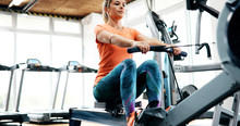 Workout Woman Cross Training Exercising Cardio Using Rowing Machine