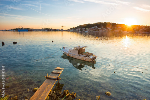 boot moored at the wooden pier in harbour of Losinj town, Croatia Wallpaper Mural