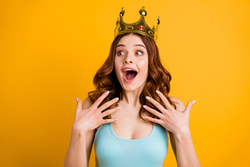 Photo of foxy lady nominated as college celebrity wear big golden headwear and tank-top isolated yellow background