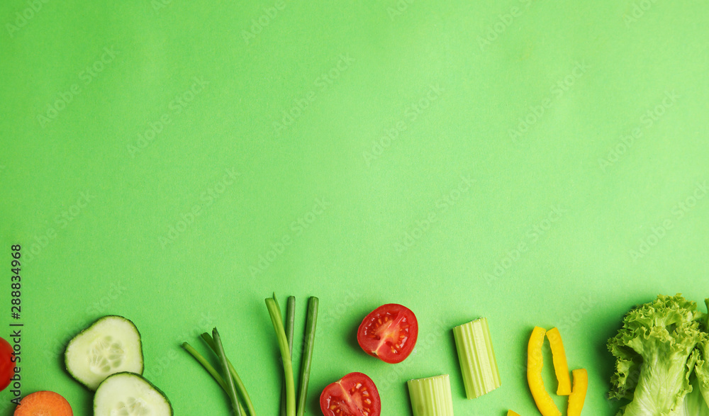 Fototapeta Flat lay composition with fresh salad ingredients on green background, space for text