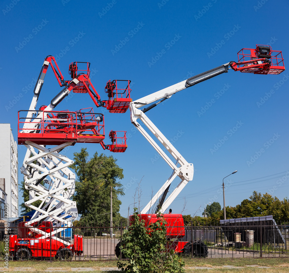 Fototapety, obrazy: Different self propelled articulated boom lifts and one scissor lift