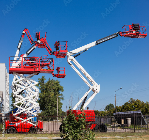 Different self propelled articulated boom lifts and one scissor lift Wallpaper Mural