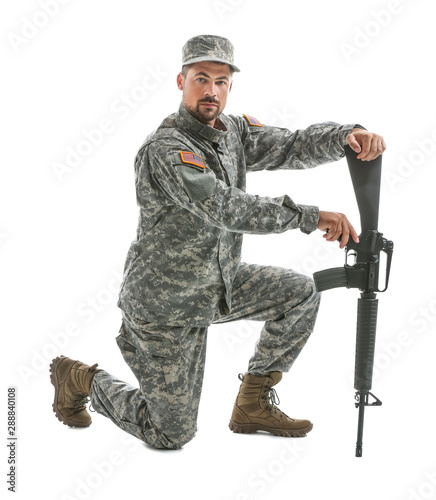 Photo  Soldier with assault rifle on white background