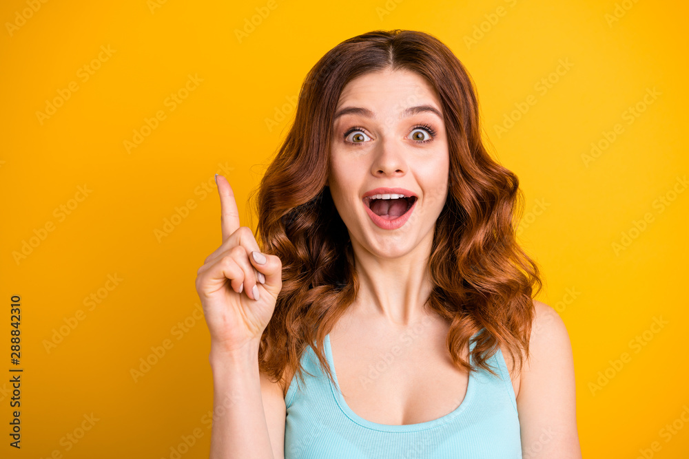 Fototapeta Photo of charming casual cute nice beautiful attractive pretty sweet lovely trendy white girlfriend wearing turquoise singlet pointing up after realizing while isolated over yellow background
