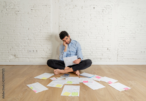 Fototapeta  Lifestyle portrait of stressed overwhelmed young man managing own investment bus