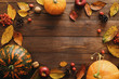 canvas print picture - Autumn frame made of pumpkins, dried fall leaves, apples, red berries, walnuts, pine cones on wooden table. Thanksgiving, Halloween, Autumn Harvest concept. Flat lay composition, top view, copy space