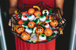 canvas print picture Woman offering funny Haloween candy at the front door