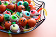 canvas print picture Funny Halloween candy in a spiderweb tray