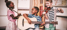 Children Playing Musical Instr...