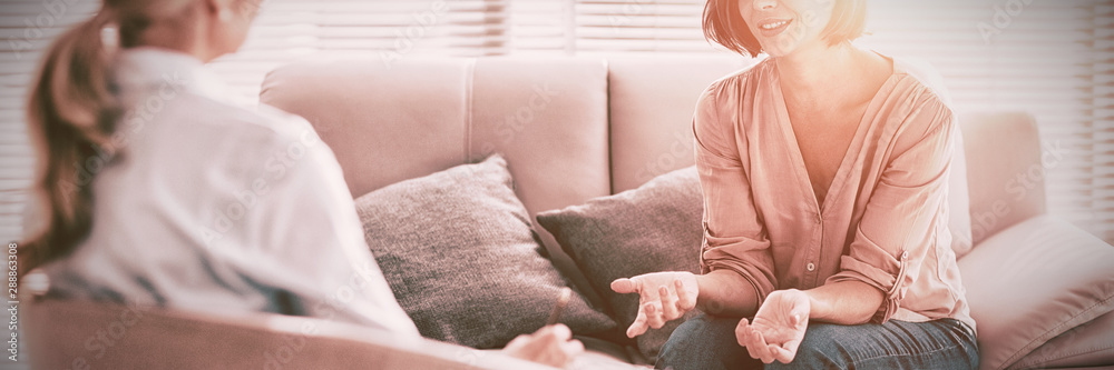 Fototapeta Woman talking to therapist