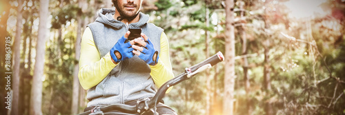 Mountain biker using mobile phone