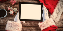 Santa Claus Holding Digital Ta...