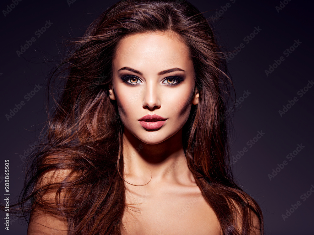 Fototapeta Face of the beautiful sexy woman with long brown hair