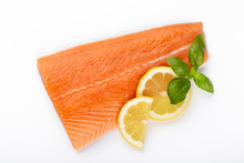 Fresh Raw Salmon Fillets With Herbs And Lemon Isolated On White Background.