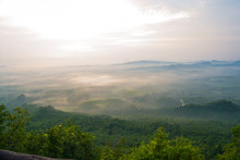 Magical Sunet With Sea Of Clouds. Landscape Photo Was Taken From Wang Pha Mek, Highlands Of Trang, Thailand.