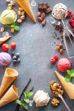 Various Varieties Of Ice Cream On Gray Stone Background