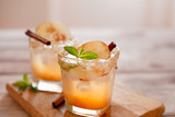 Apple cider cocktail with cinnamon and apple traditional autumn and winter drink