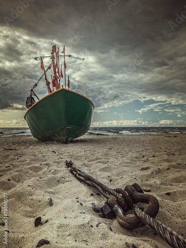 Obraz Fish cutter moored at the sandy beach - fototapety do salonu