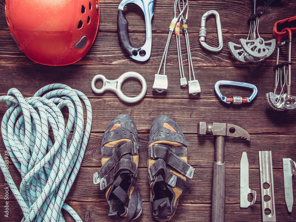 Fototapety, obrazy: climbing equipment  on dark wooden background, top view