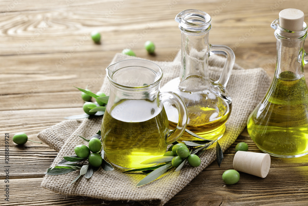 Fototapety, obrazy: olive oil and fresh green olives on wooden background