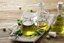 Olive Oil And Fresh Green Oliv...
