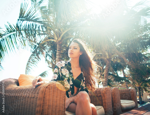 young pretty woman at swimming pool relaxing in chair, fashion look in lingerie at hotel, lifestyle people concept Wall mural