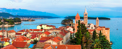 Beautiful Island Rab in Croatia. Townscape panorama over sunset.