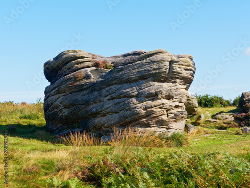 Weathered gritstone rock formation named Victory on birchen Edge Canvas Print
