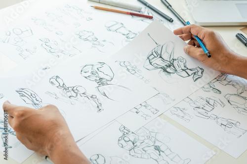 Valokuva  Animator designer Development designing drawing sketching development creating graphic pose characters sci-fi robot Cartoon illustration animation video game film production , animation design studio
