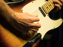 Closeup Of Man Playing Sunburst Finish Electric Guitar