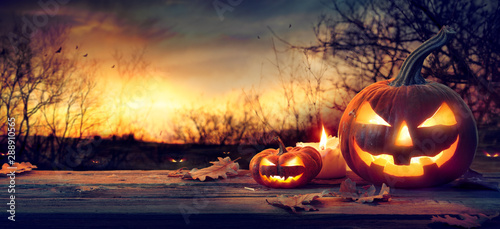 Jack O' Lanterns In Spooky Forest With Ghost Lights - Halloween Background - 288910565