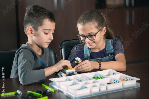 Obraz Children in the classroom collect figure from the designer. - fototapety do salonu
